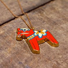 Rosie Wonders enamel Swedish Red horse necklace | Little Moose | Cute bags, gifts, toys, jewellery and accessories from independent designers and famous brands
