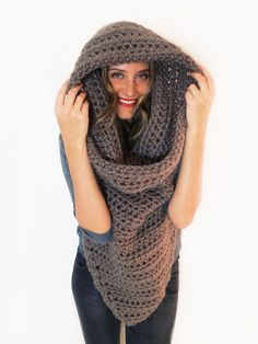 After an uncountable number of requests, I have finally created a crochet version of my beloved knit Armor Scarf, the first piece I ever designed. Behold the Battalion Scarf – a crochet beast that mimics the original's combo of scarf, cowl, poncho, and hood all in one. Worn under or over a c