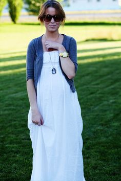 Pretty combination.. white gauzy dress, rosettes at the top of the dress, blue cardigan and pendant. from Ruche.