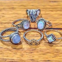 Examples of opal and moonstone rings. I love the ones beside the elephant.