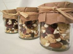 """Trail Mix in decorated baby food jars - tag could read """"Bless the broken road that led me straight to you - R+S""""."""