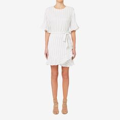 In a chic style with a simple pattern, this dress features frills on the sleeves and hem for a feminine touch. With a wrap design and tie, it's a look that can easily take you from day to night with minimum fuss. Made from viscose, it's available in sizes 6 to 14. Our model wears size 8 and is 179cm tall.