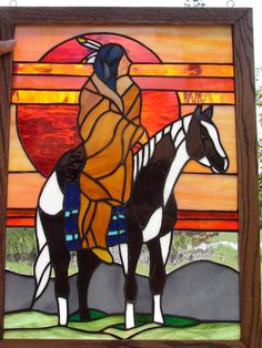 Native American riding at sunrise on his painted pony.   Stained glass from pattern completed in 2011