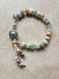 Aqua Marine facet beads on silk cord with silver button closure