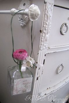 Love this white dresser with its vintage feel.