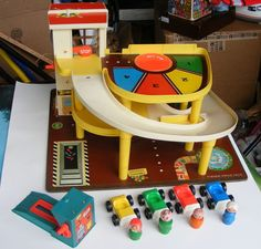 Fisher Price Little People 930 Parking Garage with Accessories I loved this garage. Played with it for hours at a time!