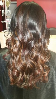 Peekaboo hilights and lowlights in blonde, copper, red and dark brown