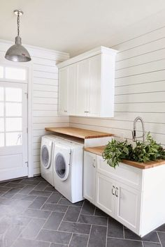 shiplap walls and wood counters in the laundry room