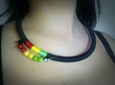 Nice and simple necklace in dominant black color with Rasta colors detail in thread and beads on the side. Wrapped with cotton thread and with added natural colored gemstone beads.On ends are gold bead end caps which making great combo with black. Length 52 cm,adjustable.