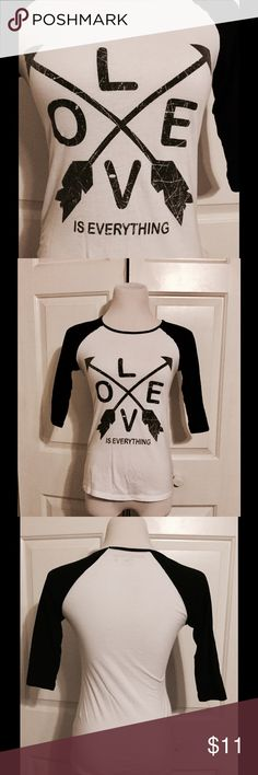 Love Is Everything Graphic Baseball T-shirt All about the message. Adorable, distressed look baseball t-shirt. Classic style, uplifting message. Looks great with jeans, or a big poofy skirt. Rebellious One Tops