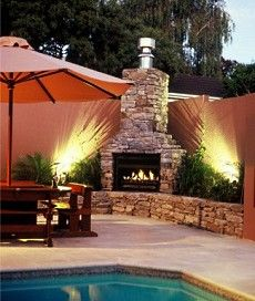 Outdoor Fireplace Design Ideas outdoor grill with see through fireplace and pergola attached to house Outdoor Stone Fireplace Design Ideas And Tips To Create A Distinctive And Uniquely Personal Outdoor Room And Stone Hearth