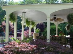 More than a pergola - a covered porch not attached to the house. Whatever it is, it's gorgeous!