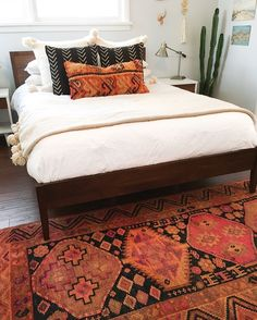 Vintage Turkish rug paired with a vintage boujad pillow & African mudcloth