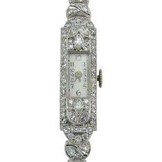 Vintage Swiss Art Deco ladies platinum diamond Glycine wrist watch, circa 1930. This Art Deco case features marquise and round diamonds with VS-SI