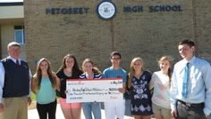 Brown Motors presents Dodge check to Petoskey High School athletes from Dodge Booster Fundraiser