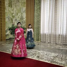 """The photos that end up on Guttenfelder's Instagram feed are often ones he says wouldn't have a home elsewhere—of the margins of a scene, of objects cast in still-life."" Inside Pyongyang's Masudae Assembly Hall two women wait to lead us down a red carpet to meet Kim Yong Nam, the head of the Presidium of the Supreme People's Assembly of North Korea, April 10, 2013."