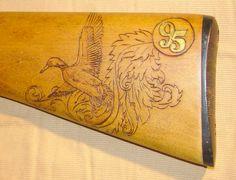 """Flying Duck on Gunstock"" - Woodburning by Charlton Wiggins; Reloading Bench, Rifle Stock, Gun Rooms, Guitar Hanger, Gun Art, Shooting Guns, Wood Carving Art, Wood Burning, Wood Projects"