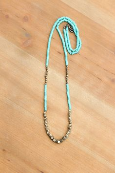 """Turquoise  Pyrite Necklace by HabitJewelry on Etsy $50 Turquoise howlite and pyrite mix in this long necklace. The pyrite varies from faceted to raw, adding texture to this piece. Silk cord. This necklace measures 32"""" long."""