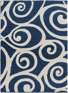Enchanting, plush area rug at an affordable price with a modern coastal appeal in dark blue shades and swirled with an ivory current design like an incoming tide.