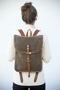 "Click photo for more info.  This small backpack is perfect for many different occasions; from a light day in the woods or a weekend carry-on, to a day of errands in the city.  Two internal pockets and a floating zippered pocket for more essential items. Handmade one at a time in my studio located in San Francisco.   Materials: #10 Waxed Canvas (15oz), leather, Solid brass roller buckles, copper rivets.  Dimensions: 16""h x 12""w x 3""d   **$260.00, Made to order.  ethanljamison@gmail.com (4 -6…"
