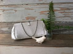 Check out this item in my Etsy shop https://www.etsy.com/listing/239545360/retro-shiny-silver-purse-with-swing