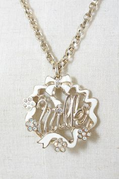 Milk: Ribbon logo necklace