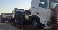 HOWO Tractor truck on flat deck, two units stacked up together. Buy HOWO truck from China supplier.
