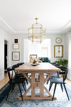colors. moldings. table. black chairs. artwork. rug. STUDIO MCGEE dining room