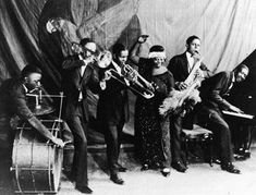 Ma Rainey and her Georgia Jazz Band photo. A history of Jazz before This site contains over 3000 songs from this era in Real Audio 3 format, as well as hundreds of biographies and discographies of Jazz musicians. Louis Armstrong, Billie Holiday, Roaring Twenties, The Twenties, 1920s Jazz, 1930s, Classic Blues, Rhapsody In Blue, Blues Artists