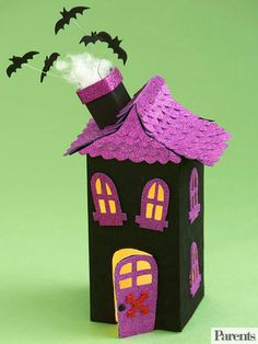 Dig into the recycling bin and pull out an empty juice carton to make this happy haunted house centerpiece. Kids can cover up the carton sides with black crafts foam and create a roof by covering the carton top with strips of scalloped-edge glitter sticker paper. Adults should cut out the windows and door using a crafts knife, but kids can help decorate the house with cutout crafts foam shutters and chimney and a collection of wired crafts foam bats. Insert a kids-safe, battery-operated…
