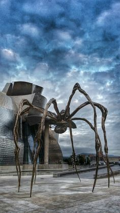 This giant spider created by Louise Bourgeois stands guard in front of the Guggenheim Museum in Bilbao Spain. Louise Bourgeois, Guggenheim Bilbao, Frank Gehry, Rem Koolhaas, Basque Country, Spain And Portugal, Zaha Hadid, Road Trip, Spain Travel