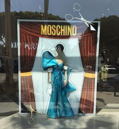 WEBSTA @ danimaloh - Got to help set up this pretty little lady display today. #moschino #windowdisplay #visuals #beverlyhills  #LA