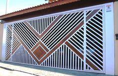 Portão Tubular Madeira EP-218 com preenchimento de metalon de aço carbono 100% galvanizado em diversos perfis. Pode conter detalhes em tubos de aço, chapa ou madeira.