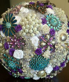 Teal, Crystal and Purple Brooch Wedding Bouquet. $450.00, via Etsy.