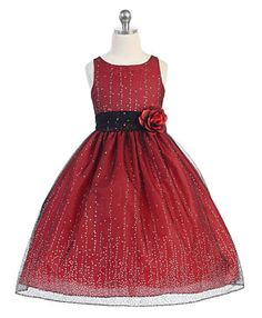 Girls Dress Style D746- Sleeveless Dress with Glitter Flocking in Choice of Color  Everything tends to be better when you add glitter to it which is why we love this classic mesh dress. The sleeveless style is full of glitter with a concentration towards the hem of the skirt.  http://www.flowergirldressforless.com/mm5/merchant.mvc?Screen=PROD&Product_Code=CA_D746R&Store_Code=Flower-Girl&Category_Code=Red