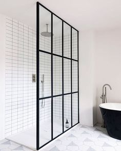 •• WOW. •• Steel grid shower screen with white grid tiles. Black and white perfection Stunning design by @studiomaclean  and first seen on the super stylish @heygents blog. #blackandwhitebathroom #steelframedoors #blackbath #gridtile #bathroomdesign #aesop #blackframe