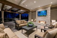 Why not incorporate a TV in to your outdoor space? What could be more perfect than watching a movie with friends & family outside on a beautiful summer night. Custom home designed by Interior Solutions Design Group www.interiorsolutionsdesigngroup.com