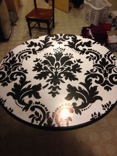 This just gave me a great idea! Paint demask on my old 80's looking dining table.