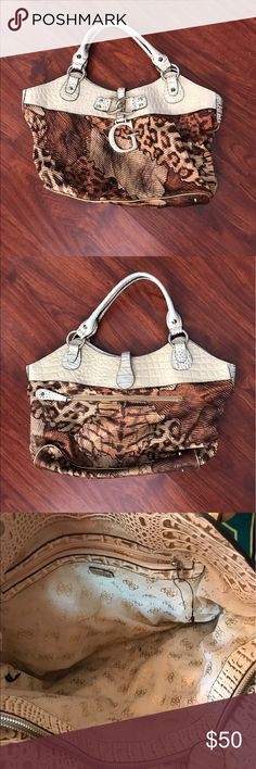 Guess handbag This Guess handbag has leather strap and  made of sturdy fabric. It's in mint condition and spotless! Bags Shoulder Bags