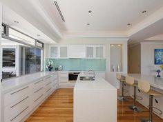 White laminex / Stone Bench top / floorboards & glass splash back