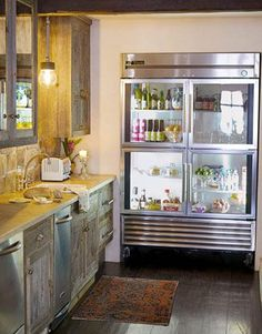 modern rustic chic with a glass fridge! Rustic Kitchen, Kitchen Decor, Glass Door Refrigerator, Cuisines Design, Beautiful Kitchens, Home Kitchens, Retro Kitchens, Luxury Kitchens, Modern Kitchens
