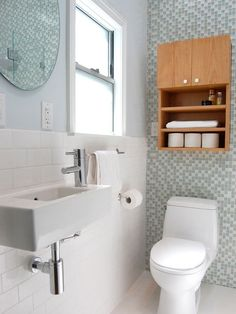 Traditional White Bathroom with Glass Tile Accent Wall Bathroom Renos, White Bathroom, Bathroom Interior, Bathroom Ideas, Master Bathroom, Bathroom Storage, Basement Bathroom, Toilet Storage, Bathroom Small