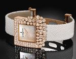 The de Grisogono 'Sugar' watch in pink gold, with diamond-set back case and bezel with 90 white diamonds at 6.51ct.
