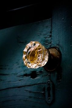 Glass knob on deep blue door.