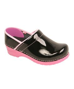 As easy on the feet as they are on the eyes, these modern clogs showcase standout style and unmatched comfort. A product of quality craftsmanship, this pair features fashionable patent uppers and a trendy two-tone look. Size note: Sanita clogs should fit with a 0.25'' (pinky finger's width) gap between the heel of the foot and the back of the clog.