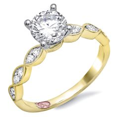 Designer Engagement Rings from DemarcoJewelry.com    Available in White or Yellow Gold 18KT and Platinum. 0.14RD  Capture her grace and endless beauty with this confident yet elegant design. We have also incorporated a unique pink diamond with every single one of our rings, symbolizing that hidden, unspoken emotion and feeling one carries in their heart about their significant other.  This is not just another ring, this is a heirloom piece of jewelry.