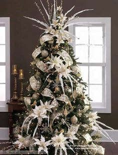 an absolutely stunning christmas tree decorating ideas with white poinsettia and beautifully garland wire edge ribbon through this tree - White Wire Christmas Tree