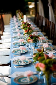 Table setting at a poolside, tented wedding at Goodstone Inn & Restaurant.