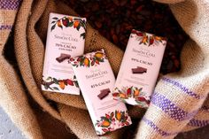 Beautiful illustrations and packaging with pods and flowers of the cocoa tree and other plants and butterflies native to Ghana, the country of origin for this delicious key ingredient in these decadent high cacao bars.​ #glutenfree #packaging