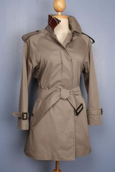 This is a 100% genuine vintage Burberry Trench Coat, labeled Burberrys, customized by our master tailor to a Modern Short Trench Coat, including the Burberry check to the back on the collar which looks fantastic when collar is turned up. More vintage Burberry coats in variable sizes and colors available in our shop. Use code Pinterest10 at check out for a 10% discount.